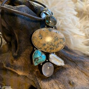 Beautiful stone necklace on leather cord